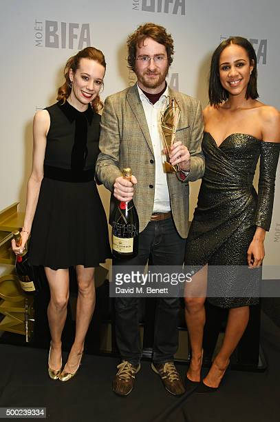 Stephen Fingleton winner of the Douglas Hickox Award for Debut Director for The Survivalist and presenters Chloe Pirrie and Zawe Ashton pose at the...