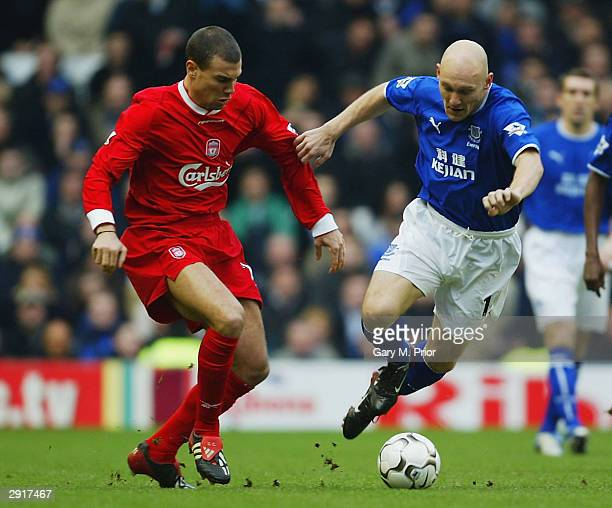 Stephen Finnan of Liverpool clashes with Thomas Gravesen of Everton during the FA Barclaycard Premiership match between Liverpool and Everton at...