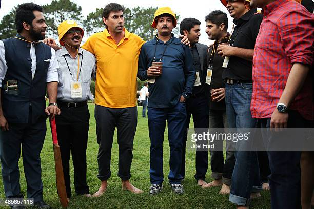Stephen Fleming gives a pep talk to his team during a backyard cricket match captained by Kiwi cricket greats Sir Richard Hadlee and Stephen Fleming...