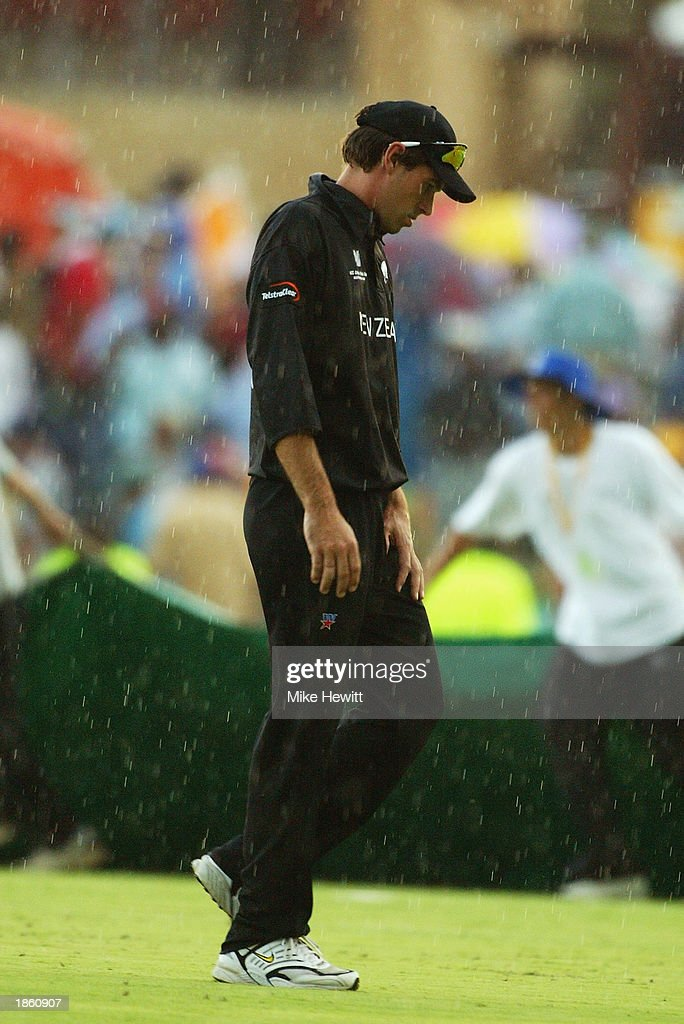 Stephen Fleming of New Zealand leaves the pitch in the rain after the ICC Cricket World Cup Super Six match between New Zealand and India held on March 14, 2003 at Supersport Park in Centurion, South Africa. India won the match by 7 wickets.