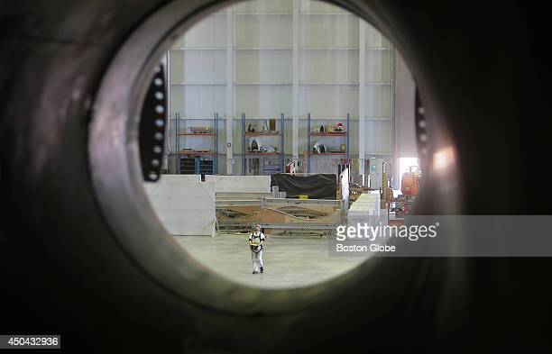 Stephen Flesher a blade test technician is seen through the empty port of a testing station one of three at the Wind Technology Testing Center in the...