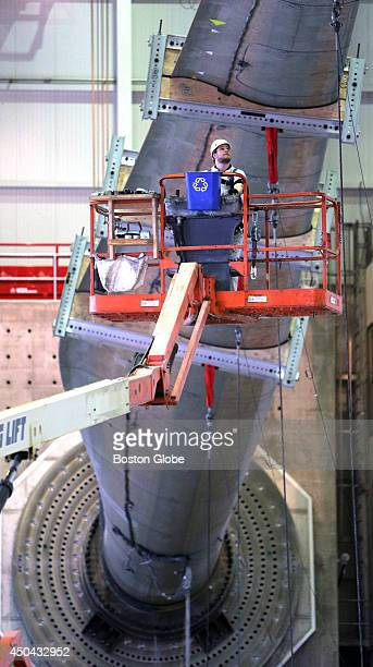 Stephen Flesher a blade test technician removes cables from the recently delivered 200foot blade The Wind Technology Testing Center in the Boston...