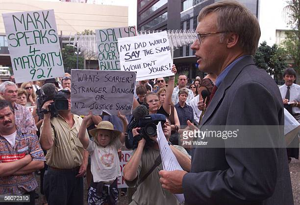 Stephen Franks addresses a crowd of people protesting for the freedom of Mark Middleton who was appearing in the Auckland Distrct Court charged with...