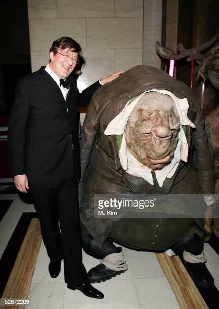 Stephen Fry poses with a Vogon costume from the film 'The Hitchhiker's Guide to the Galaxy' during the aftershow party following the world premiere...