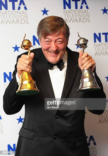 Stephen Fry poses with his Most Popular Documentary award and Special Recognition award at the National Television Awards held at O2 Arena on January...