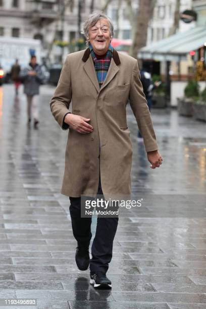 Stephen Fry seen walking from his local polling station through Leicester Square on December 12, 2019 in London, England.