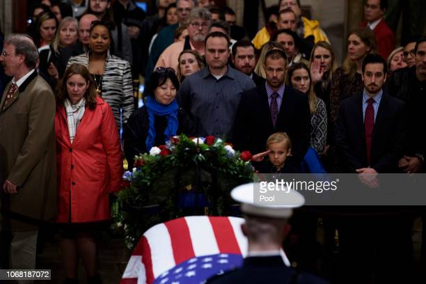 Stephen G Leighton Jr salutes while paying respects with his father Stephen G Leighton Sr as former President George HW Bush lies in state in the US...