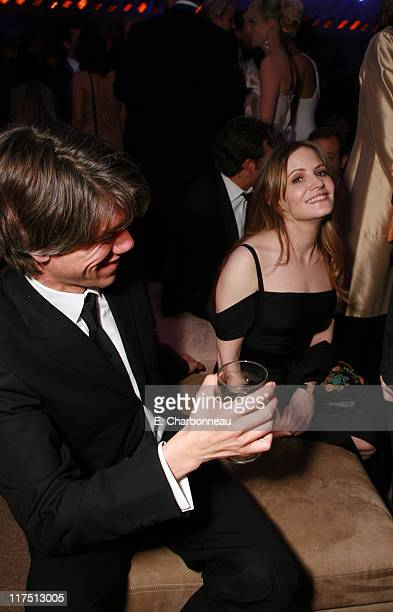 Stephen Gaghan and Jennifer Jason Leigh during 2006 Vanity Fair Oscar Party Hosted by Graydon Carter at Morton's in Beverly Hills California United...