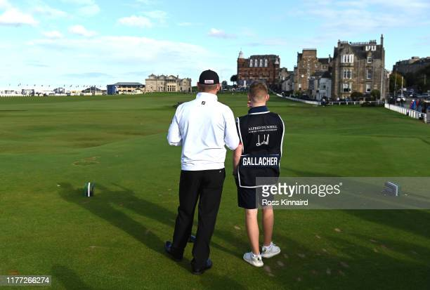 Stephen Gallacher of Scotland and his son Jack Gallacher on the 18th tee during Day one of the Alfred Dunhill Links Championship at The Old Course on...