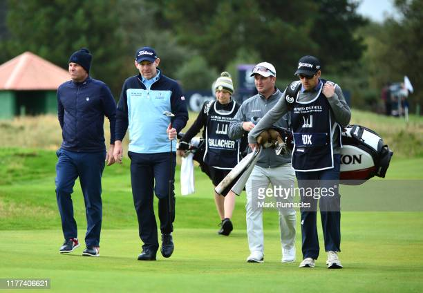Stephen Gallacher of Scotland and Ryan Fox of Australia walks the 13th with former cricket player Shane Warne during Day two of the Alfred Dunhill...
