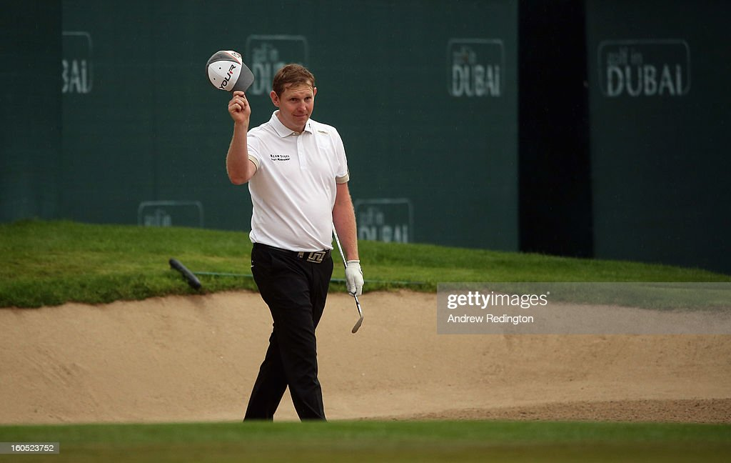 Stephen Gallacher of Scotland celebrates after holing his bunker shot for an eagle on the 18th hole during the third round of the Omega Dubai Desert Classic at Emirates Golf Club on February 2, 2013 in Dubai, United Arab Emirates.