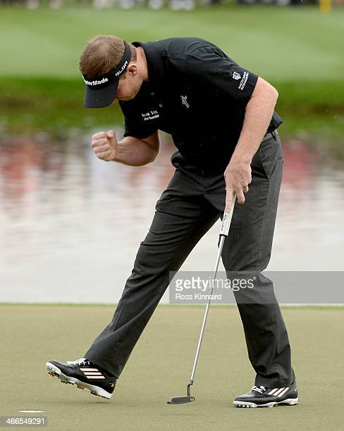 Stephen Gallacher of Scotland celebrates after holing his putt on the 18th green during the final round of the Omega Dubai Desert Classic on the...