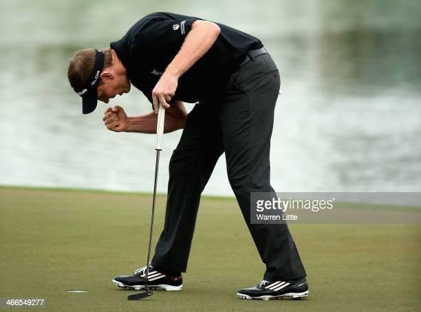 Stephen Gallacher of Scotland celebrates winning the 2014 Omega Dubai Desert Classic on the Majlis Course at the Emirates Golf Club on February 2,...