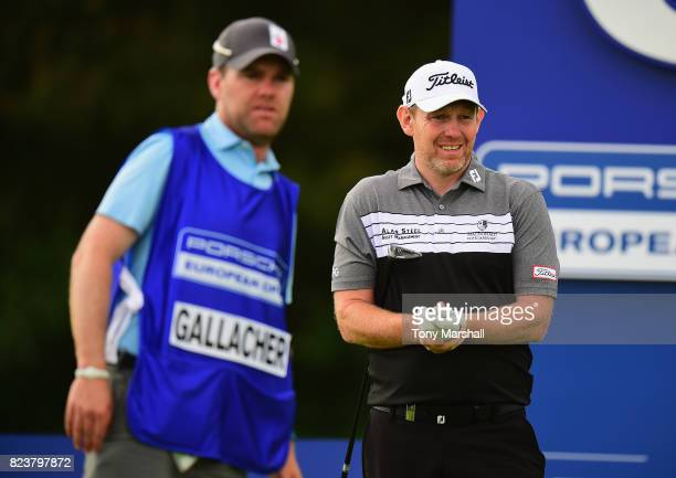 Stephen Gallacher of Scotland holds his wrist after playing his first shot on the 6th tee during the Porsche European Open Day Two at Green Eagle...