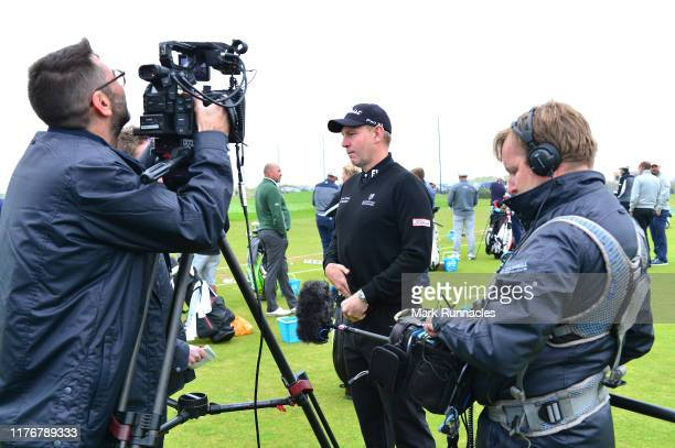 Stephen Gallacher of Scotland is interviewed during previews for the Alfred Dunhill Links Championship at The Old Course on September 24 2019 in St...