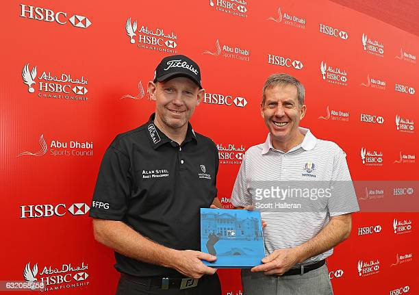 Stephen Gallacher of Scotland is presented with a commemorative gift by Keith Waters Chief Operating Officer of the European Tour after making his...