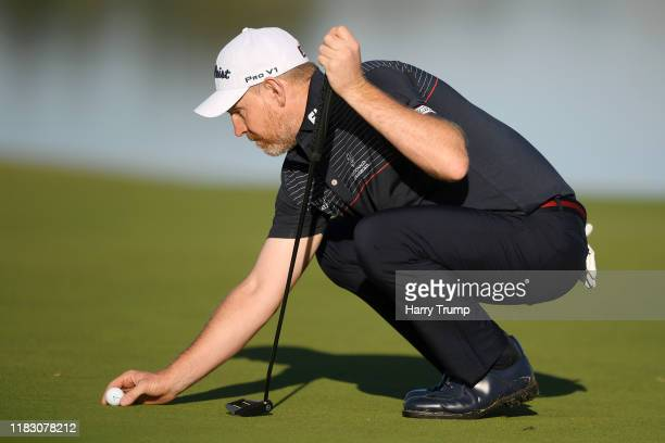Stephen Gallacher of Scotland lines up a putt on the 3rd green during Day One of the Portugal Masters at Dom Pedro Victoria Golf Course on October 24...