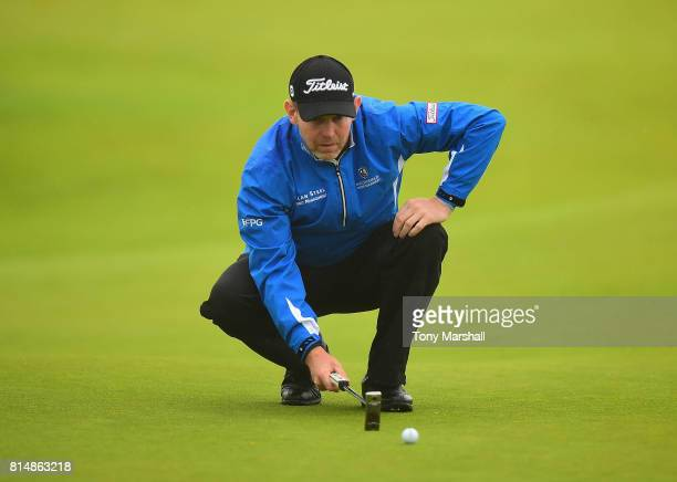 Stephen Gallacher of Scotland lines up his putt on the 1st green during Day Three of the AAM Scottish Open at Dundonald Links Golf Course on July 15...