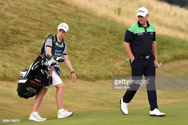 Stephen Gallacher of Scotland looks on with his caddy son Jack Gallacher on hole one during day four of the Aberdeen Standard Investments Scottish...