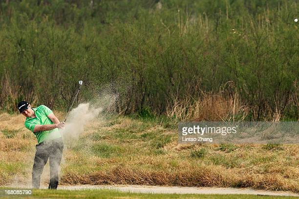 Stephen Gallacher of Scotland plays a shot during the during the final round of the Volvo China Open at Binhai Lake Golf Course on May 5, 2013 in...