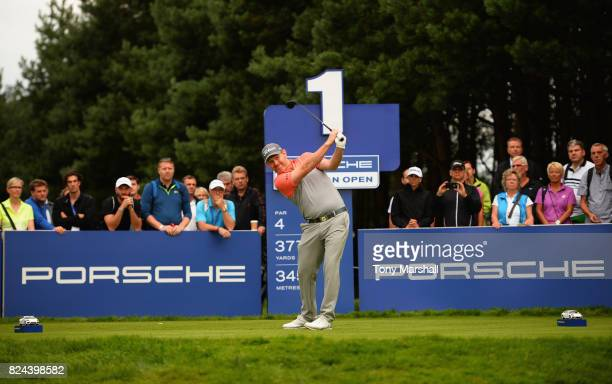 Stephen Gallacher of Scotland plays his first shot on the 1st tee during the Porsche European Open Day Four at Green Eagle Golf Course on July 30...