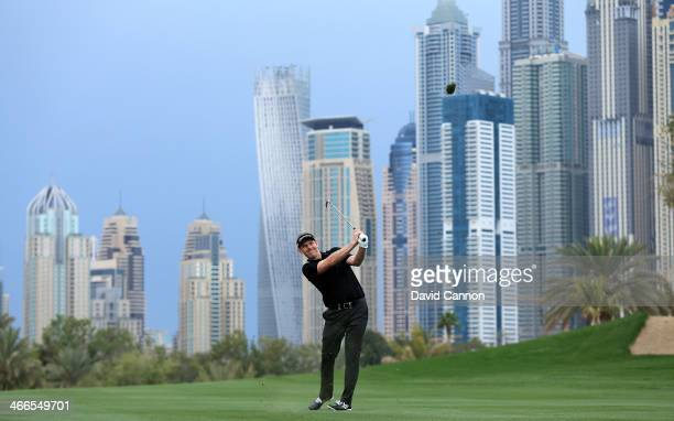 Stephen Gallacher of Scotland plays his second shot at the par 5, 13th hole during the final round of the 2014 Omega Dubai Desert Classic on the...