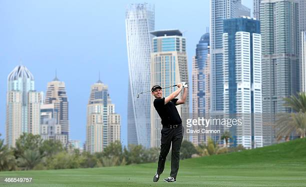 Stephen Gallacher of Scotland plays his second shot at the par 5 13th hole during the final round of the 2014 Omega Dubai Desert Classic on the...