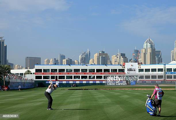 Stephen Gallacher of Scotland plays his second shot at the par 5, 18th hole during the first round of the 2014 Omega Dubai Desert Classic on the...
