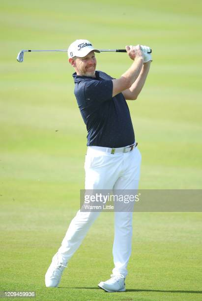 Stephen Gallacher of Scotland plays his second shot into the 12th green during the third round of the Oman Open at Al Mouj Golf on February 29 2020...