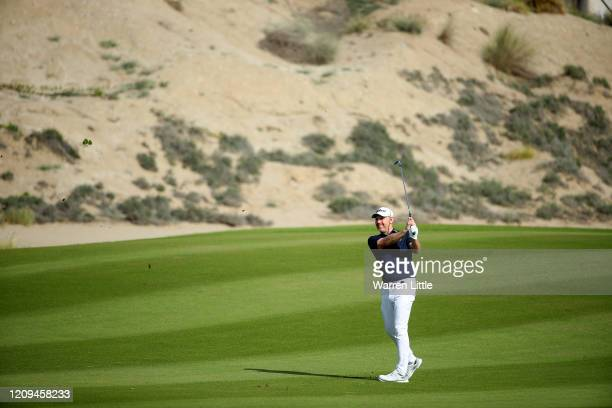 Stephen Gallacher of Scotland plays his second shot into the 15th green during the third round of the Oman Open at Al Mouj Golf on February 29 2020...