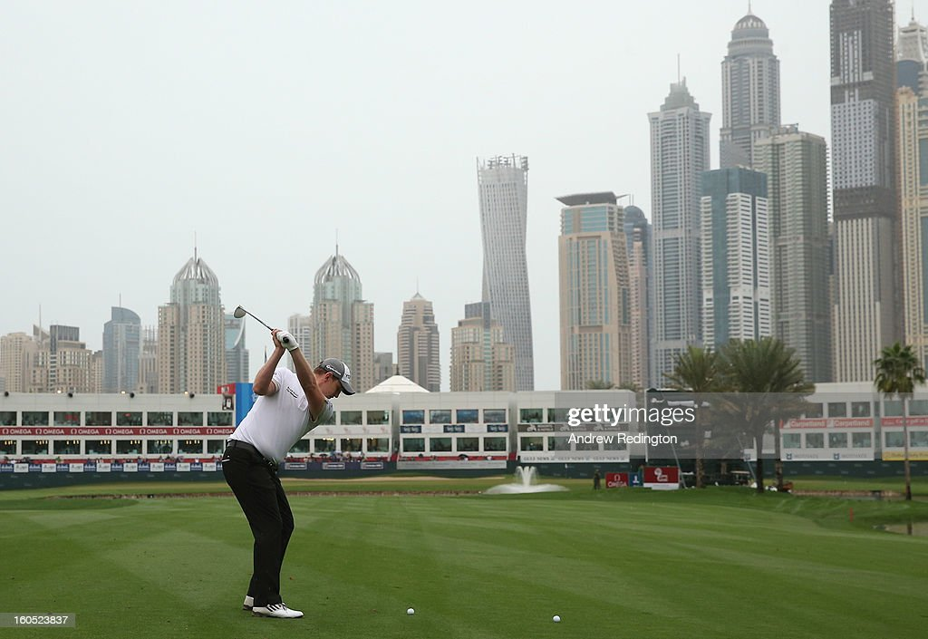 Stephen Gallacher of Scotland plays his second shot on the 18th hole during the third round of the Omega Dubai Desert Classic at Emirates Golf Club on February 2, 2013 in Dubai, United Arab Emirates.