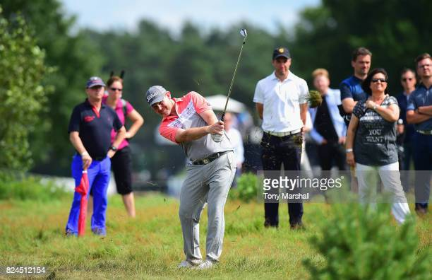 Stephen Gallacher of Scotland plays his second shot on the 18th fairway during the Porsche European Open Day Four at Green Eagle Golf Course on July...
