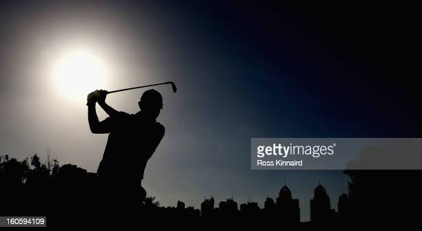 Stephen Gallacher of Scotland plays his second shot on the par five 18th hole during the final round of the Omega Dubai Desert Classic on February 3,...