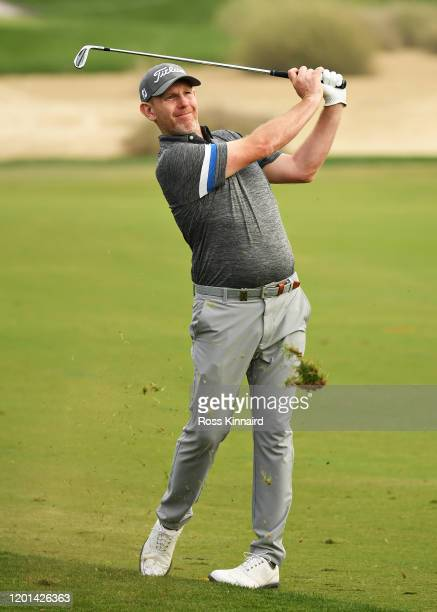 Stephen Gallacher of Scotland plays his second shot on the sixteenth hole during Day One of the Omega Dubai Desert Classic at Emirates Golf Club on...
