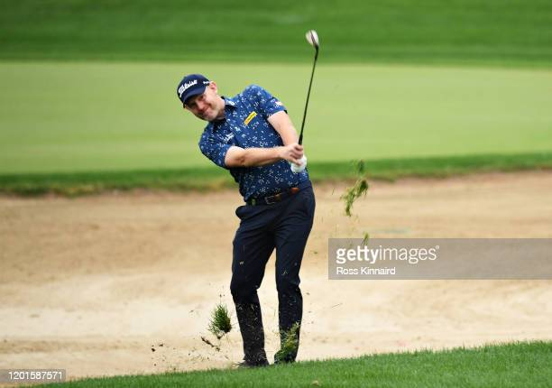 Stephen Gallacher of Scotland plays his second shot on the tenth hole during Day Two of the Omega Dubai Desert Classic at Emirates Golf Club on...