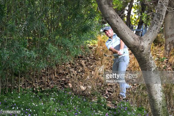 Stephen Gallacher of Scotland plays his third shot on the 4th hole during round two of the Hero Indian Open at the DLF Golf & Country Club on March...