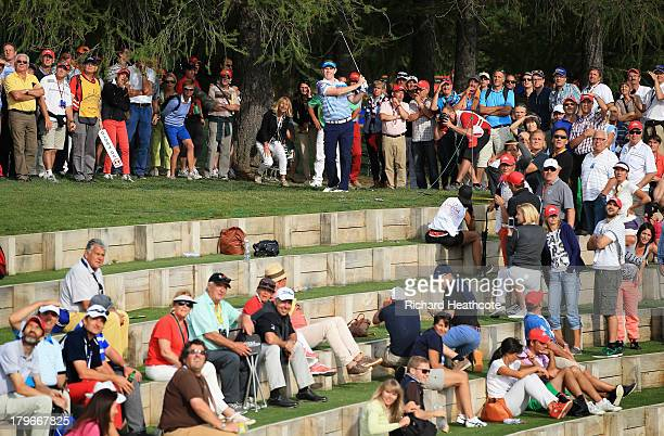 Stephen Gallacher of Scotland plays into the 17th green from the gallery watching the 13th green during the second round of the Omega European...