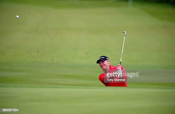 Stephen Gallacher of Scotland plays out of a bunker onto the 18th green during the Aberdeen Asset Management Paul Lawrie Matchplay ProAm at...