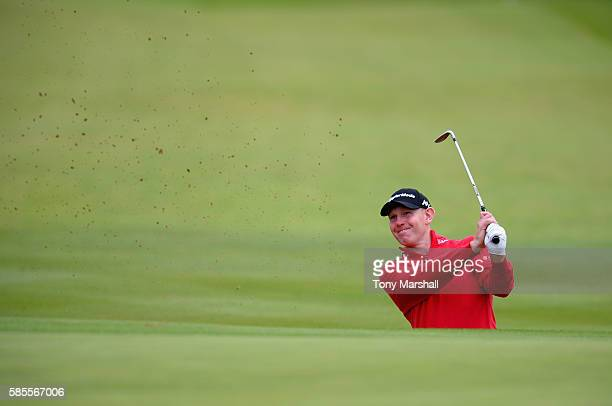 Stephen Gallacher of Scotland plays out of a bunker onto the 18th green during the Aberdeen Asset Management Paul Lawrie Matchplay ProAm at...