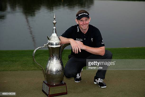 Stephen Gallacher of Scotland poses wih the trophy after winning the 2014 Omega Dubai Desert Classic on the Majlis Course at the Emirates Golf Club...