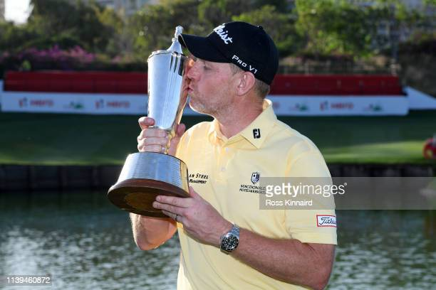 Stephen Gallacher of Scotland poses with the trophy after he wins the final round on day four of the Hero Indian Open at the DLF Golf & Country Club...