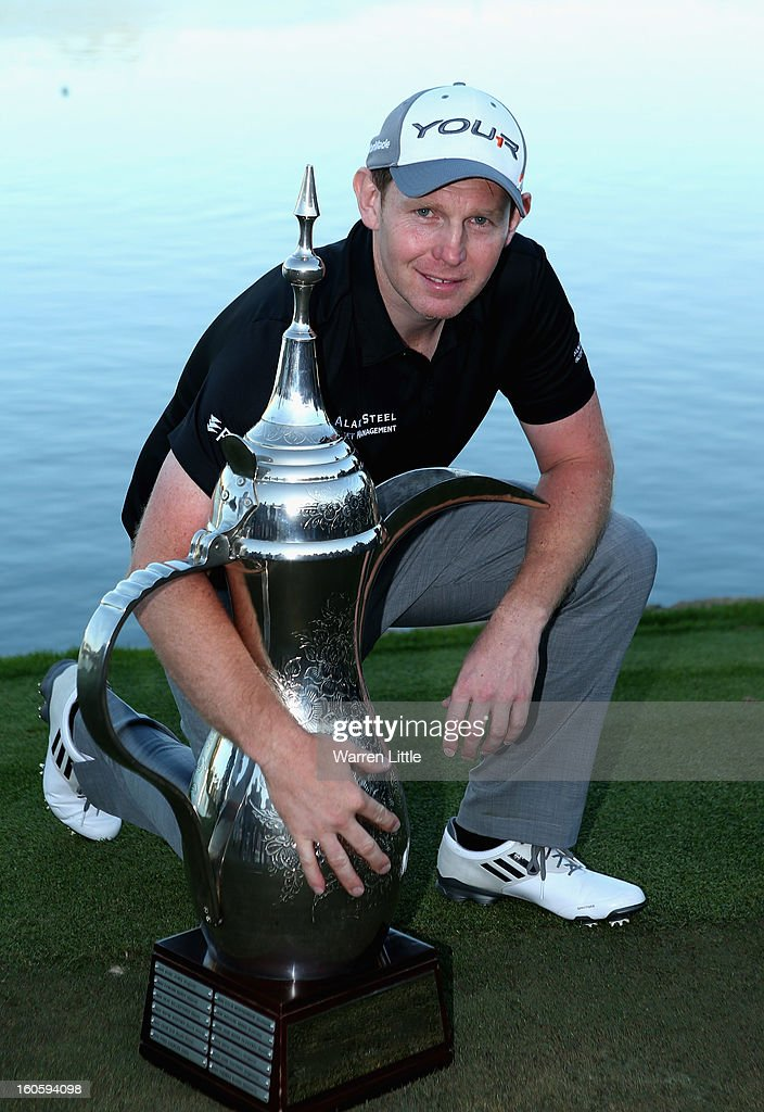 Stephen Gallacher of Scotland poses with the trophy after winning the Omega Dubai Desert Classic at Emirates Golf Club on a score of -22 under par on February 3, 2013 in Dubai, United Arab Emirates.