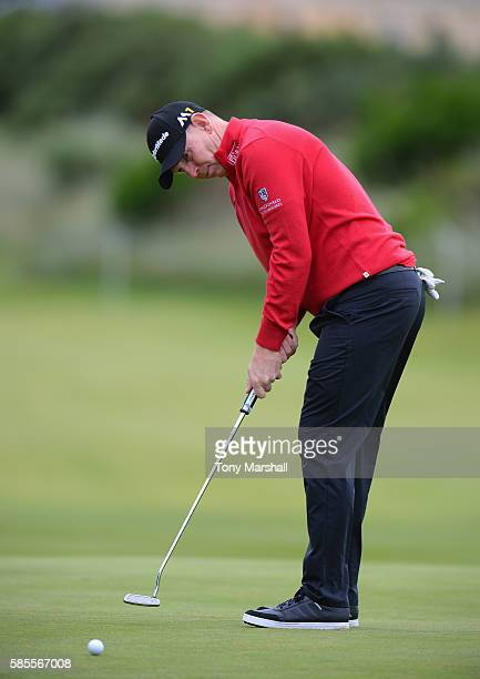 Stephen Gallacher of Scotland putts on the 18th green during the Aberdeen Asset Management Paul Lawrie Matchplay ProAm at Archerfield Links Golf...