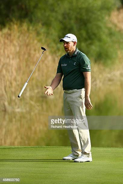 Stephen Gallacher of Scotland reacts to missing a putt on the 9th green during the first round of the 2014 Turkish Airlines Open at The Montgomerie...