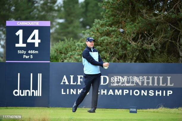 Stephen Gallacher of Scotland tees off on the 14th hole during Day two of the Alfred Dunhill Links Championship at Carnoustie Golf Links on September...