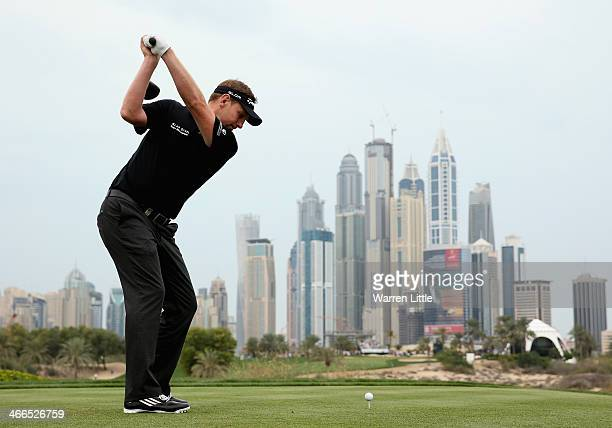 Stephen Gallacher of Scotland tees off on the eighth hole during the final round of the 2014 Omega Dubai Desert Classic on the Majlis Course at the...