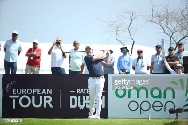 Stephen Gallacher of Scotland tees off on the first hole during the third round of the Oman Open at Al Mouj Golf on February 29 2020 in Muscat Oman