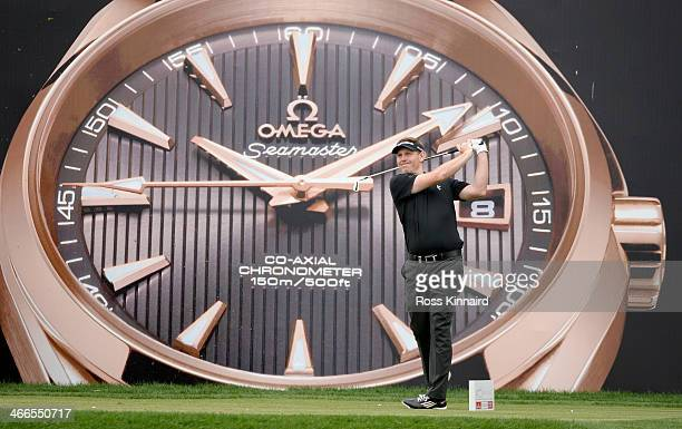 Stephen Gallacher of Scotland watches his shot on the par three 7th hole during the final round of the Omega Dubai Desert Classic on the Majlis...