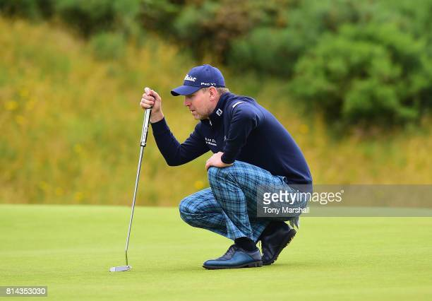 Stephen Gallacher of Scotland wearing Tartan trousers lines up his putt on the 9th green during Day Two of the AAM Scottish Open at Dundonald Links...