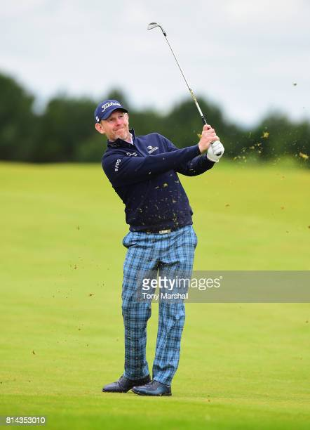 Stephen Gallacher of Scotland wearing Tartan trousers plays his second shot on the 9th fairway during Day Two of the AAM Scottish Open at Dundonald...